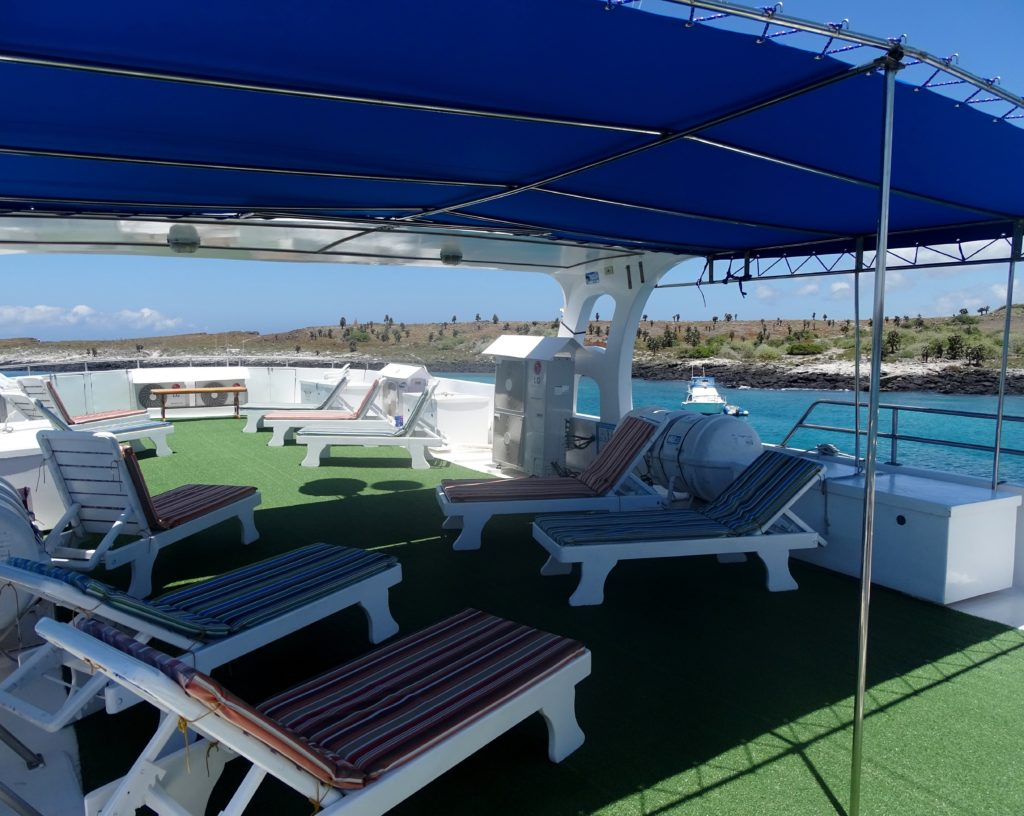 Sundeck onboard the best Galapagos budget friendly cruise
