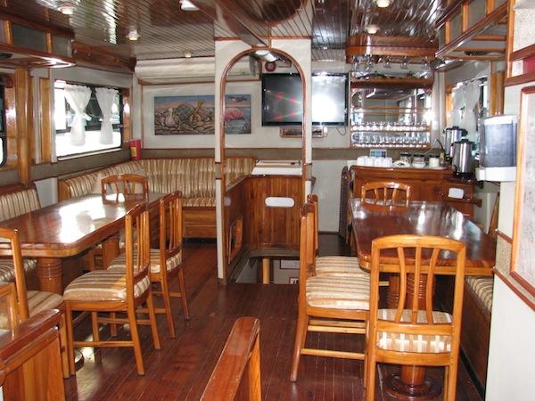 Saloon onboard a comfortable Galapagos yacht