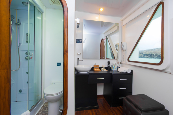 spacious and pristine bathroom onboard the deluxy luxury Galapagos cruise Petrel.