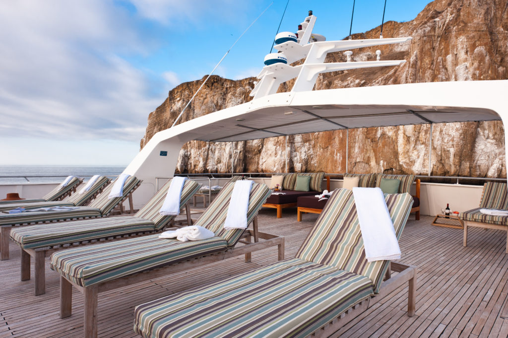 Relax on the sundeck of the First-Class Galapagos Experience