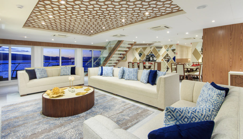 A sophisticated interior lounge onboard the Elite Galapagos Luxury Expedition